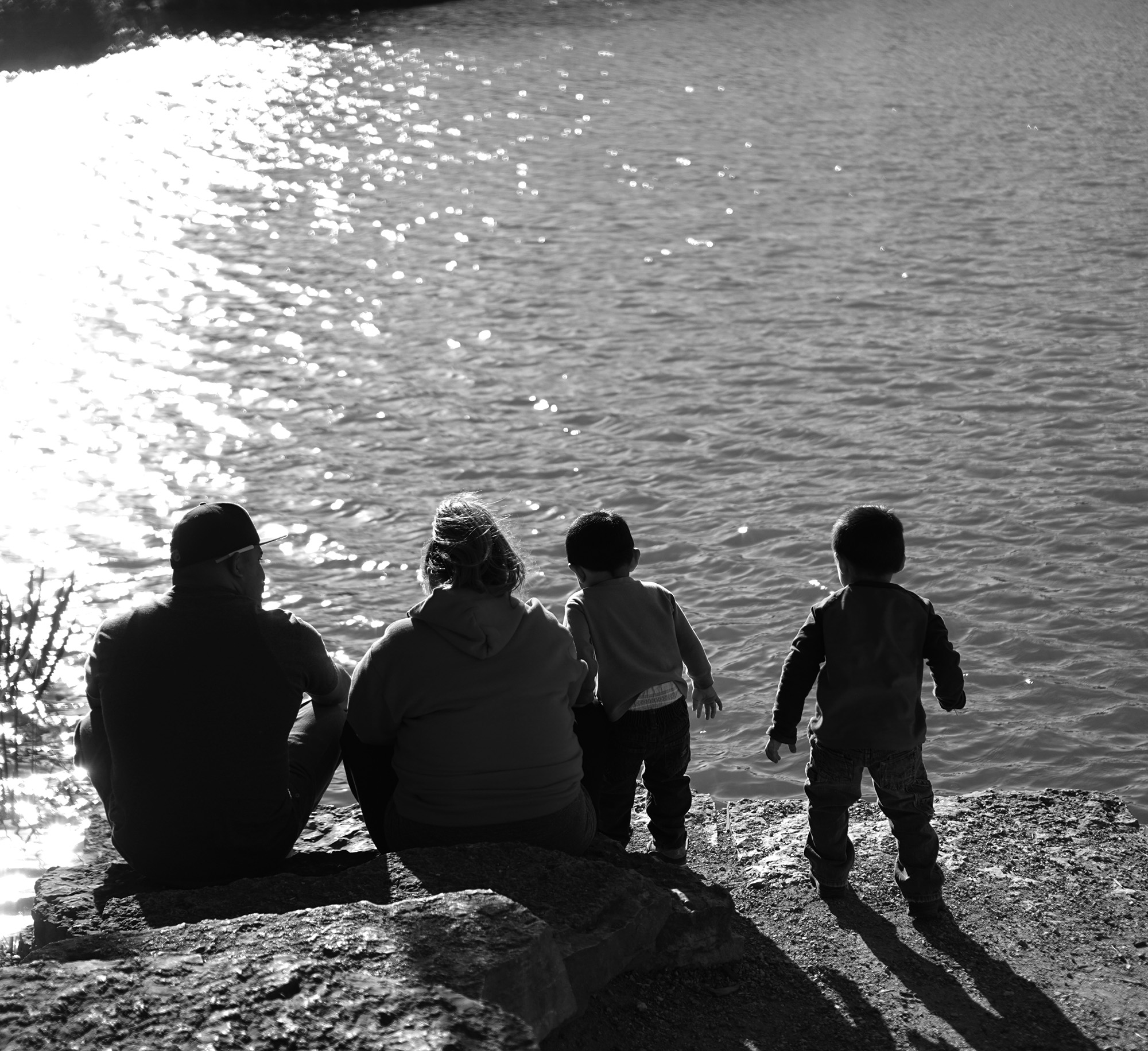 Family at Humboldt Park lagoon, Chicago / Darker than Green